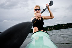 Young girl paddling in kayak Stock Images