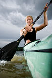 Young girl paddling in kayak Royalty Free Stock Photo
