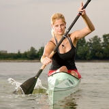 Young girl paddling in kayak Stock Photos