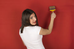 Young girl with a paint brush Royalty Free Stock Photos
