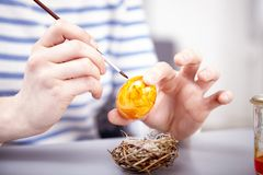 Young girl paint eggs for easter Royalty Free Stock Image