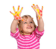 Young Girl With Paint on Hands. Isolated over white background royalty free stock images