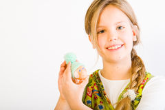 Young girl with painted egg with hat Stock Photos
