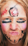 Young girl with painted face Royalty Free Stock Photo