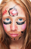 Young girl with painted face Royalty Free Stock Photography