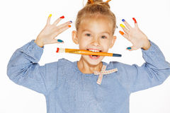 Young girl - painter. A little painter with colored fingers and a charming smile Stock Photos