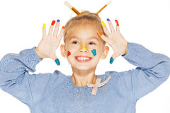 Young girl - painter. A little painter with colored fingers and a charming smile Stock Images