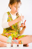 Young girl painting easter eggs Stock Images
