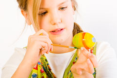 Young girl painting easter eggs Royalty Free Stock Image