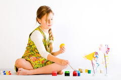 Young Girl Painting Eggs Royalty Free Stock Images