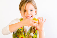 Young girl painting eggs Stock Photography