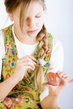 Young girl painting eggs for easter Royalty Free Stock Image