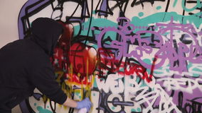 Young girl painting graffiti stock footage