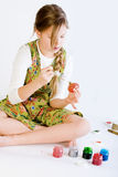 Young girl painting her easter eggs Royalty Free Stock Photography