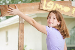Young girl painting a lemonade stand sign Royalty Free Stock Images