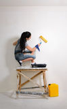 Young girl painting while redecorating Stock Photos