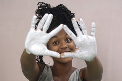 Young girl painting and soiling, african girl Stock Photo