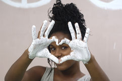 Young girl painting and soiling, african girl Stock Image