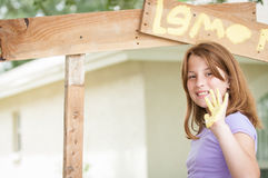 Young girl paintng lemonade stand Royalty Free Stock Images