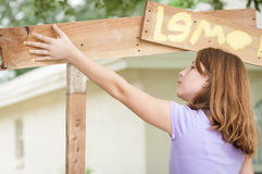 Young girl paintng lemonade stand Royalty Free Stock Image