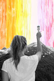 A young girl paints with a brush watercolor sky, concept Royalty Free Stock Image