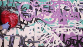 Young girl paints a graffiti stock video footage