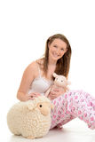 Young girl in pajamas Stock Image