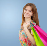A young girl with paper bags Stock Photography