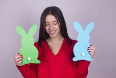 Young girl with paper bunnies. Beautiful happy young teen girl with two paper bunnies isolated Stock Photos
