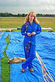 The young girl parachutist in airdrome. Portrait young sportswomen of parashute  competition Royalty Free Stock Photos