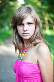 Young Girl in park Royalty Free Stock Image