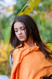 Young girl in a park in autumn Royalty Free Stock Photos