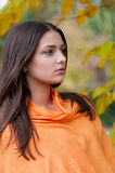 Young girl in a park in autumn Stock Photography