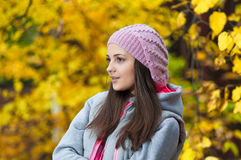 Young girl in a park in autumn Stock Images