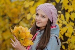 Young girl in a park in autumn Stock Photo