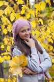 Young girl in a park in autumn Royalty Free Stock Images