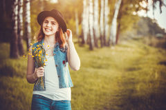 Young girl in the park with flowers Royalty Free Stock Image