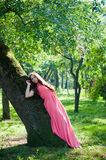 Young girl in a park royalty free stock images