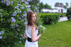 Young girl in a park. Young girl resting in a park with flowers Stock Photo
