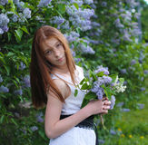 Young girl in a park. Young girl resting in a park with flowers Stock Images