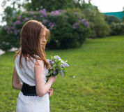 Young girl in a park. Young girl resting in a park with flowers Royalty Free Stock Photography
