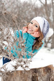 Young girl in a park on the snow Stock Photography