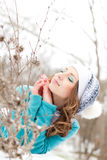 Young girl in a park on the snow Royalty Free Stock Image