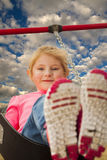 Young girl at the park swinging Royalty Free Stock Images
