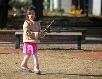 YOUNG GIRL IN PARK Stock Photo
