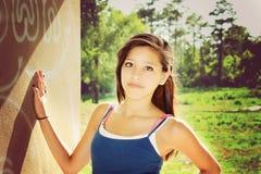 Young girl in a park Stock Photos