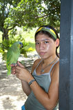 Young girl with parrot Stock Photography