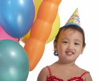 Young girl with party hat Stock Images