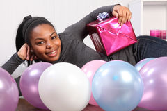 Young girl party time with present and balloons Royalty Free Stock Image