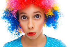 Young girl with party wig. Beautiful young girl with party wig isolated on white Stock Image